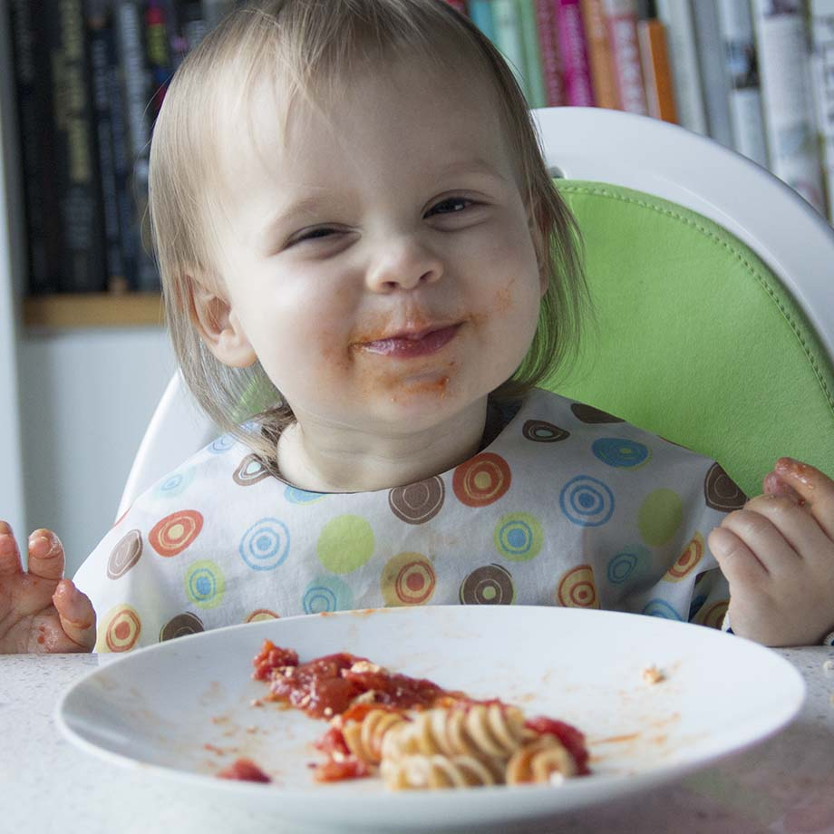 Toddler with tomato sauce face